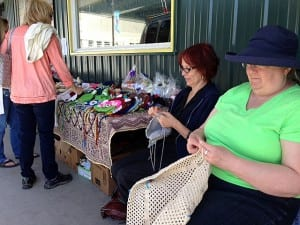 Jeane Osborne and Gladys Carter crochet at a booth in downtown Petersburg. Photo/Angela Denning