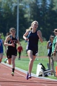 Kayleigh Eddy runs in a relay at the regional meet in Juneau. (Photo courtesy of Brad Taylor, Viking Track and Field)