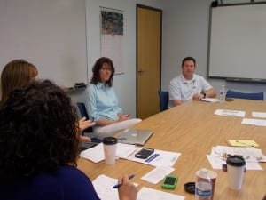 Sandra Stevens center interviews with Jay Lister and other members of the Petersburg school board Friday.