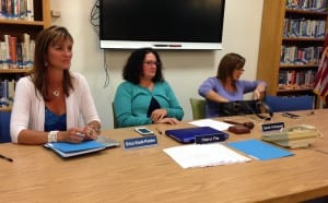 Superintendent Erica Kludt-Painter sits with school board members Cheryl File and Sarah Holmgrain at a meeting Aug. 9, 2016