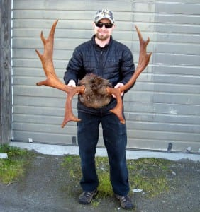 Bjorn Stolpe of Petersburg stands with the antlers of his legal moose taken near Pt. Agassiz. Photo courtesy of Rich Lowell