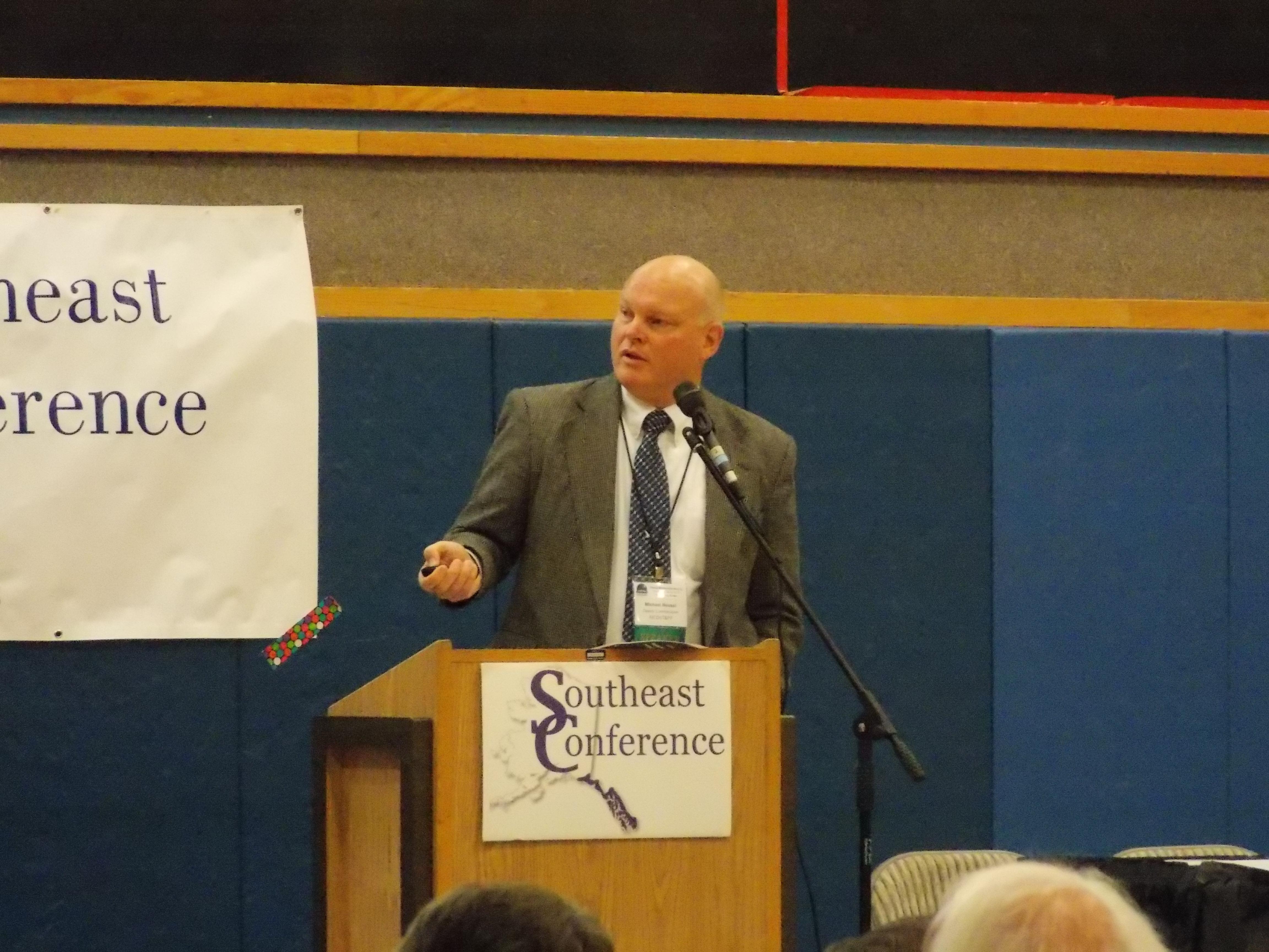 Alaska Department of Transportation deputy commissioner Mike Neussl addresses the Southeast Conference annual meeting September 21, 2016.