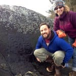 This past January, Petersburg residents, Eric Castro and Angela Christensen pose by the petroglyphs at Sandy Beach. Photo/Angela Denning