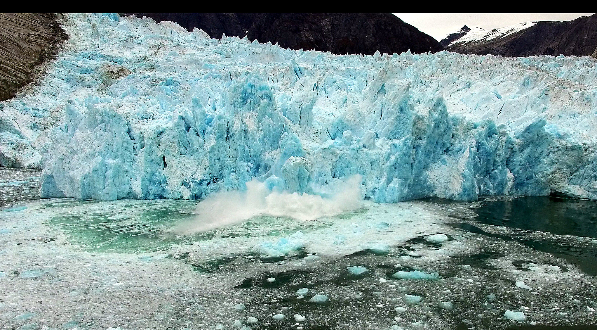 An ice chunk falling of Leconte Glacier causes a huge splash. Photo/Elliot Nash