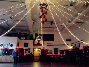 Sally Dwyer stands in a decorated Sons of Norway hall in 2015. Photo/Angela Denning