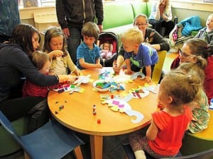 Young children make art at the public library during an open play program. Photo courtesy of Petersburg Public Library