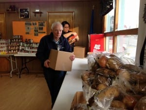 Volunteers Steve Homer and Mysti Birks pack Thanksgiving boxes for the Salvation Army Church. Photo/Angela Denning