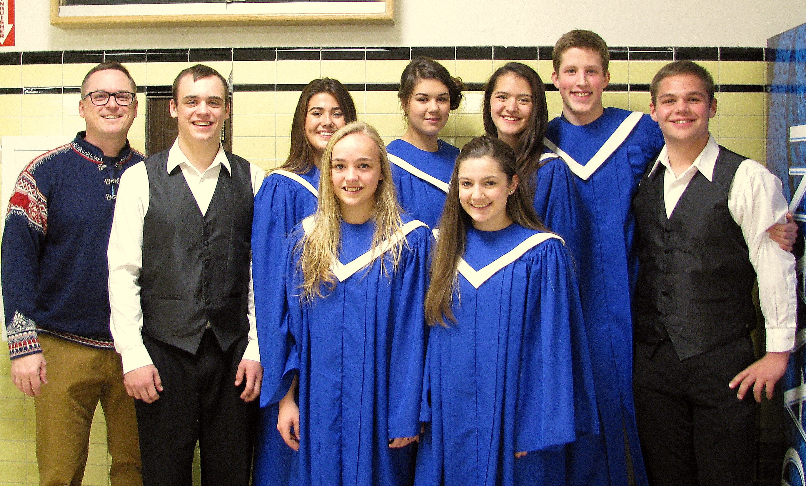 Music teacher Matt Lenhard poses with the eight students who went to the All-State Music Festival: (L-R) Matt Lenhard, Senior Nathaniel Lenhard, Junior Jasmine Ieremia, Sophomore Eva Lenhard, Senior Kelsa Sperl, Freshman Brooklyn Dormer, Junior Julia Murph, Senior Ben Higgins, Junior Brandon Ware. Photo courtesy of Matt Lenhard