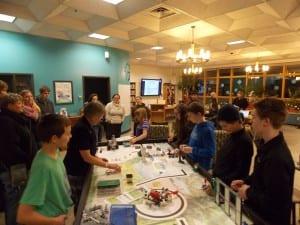 From left, Malcolm Fry, Joyce Metsa, Jaden Perry, Liam Demko, Ben Marsh and Isaiah Slaven demonstrate robotics programming to the school board Tuesday.