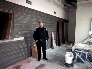 Police Chief, Kelly Swihart, stands in the unfinished lobby near the front entrance of the new police department. Photo/Angela Denning