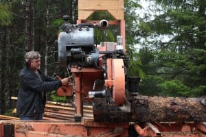 Chris Fry milling a spruce log