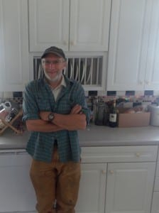 Paul Sharpe, the Lighthouse Keeper for the summer 2015 season, stands in his kitchen.(Joe Sykes)