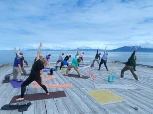 A mass yoga session on the helipad of the lighthouse.(Joe Sykes)