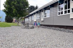 Two grade school aged girls walk in the new rock garden in front of Rae Stedman Elementary. Photo/Angela Denning