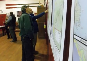 Petersburg resident, Jeff Meucci, points to a lands map while Ed Wood looks on. Photo/Angela Denning